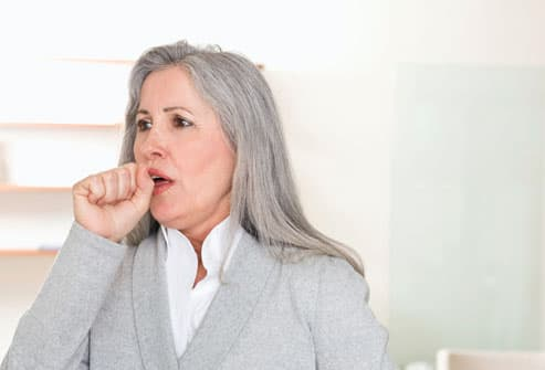 Woman Having Coughing Fit