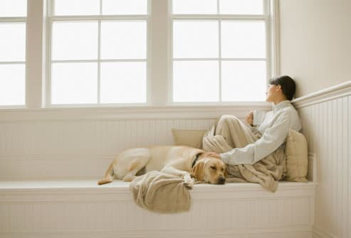 Woman With Lupus Sitting With Dog