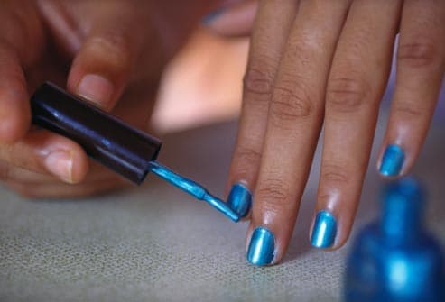 applying blue nail polish