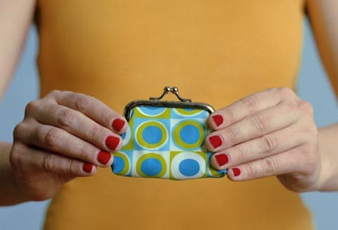 woman holding change purse