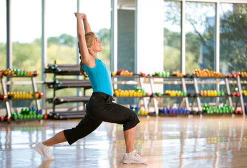 Woman stretching in exercise studio