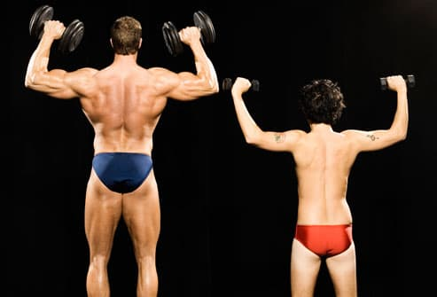 Bodybuilder and regular guy lifting weights