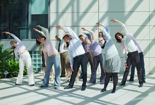 Office Workers Stretching Outside