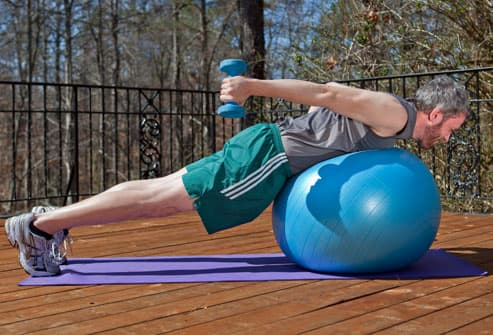 Man Doing Ball Plank