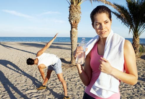 couple working out on the beach