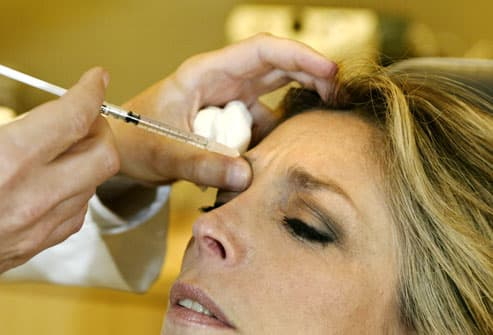 Doctor Injecting Botox into Woman's Forehead