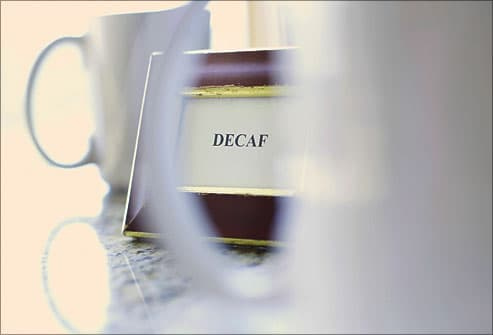 Decaf placard on coffee table