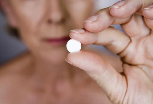 Senior Woman Holding White Pill