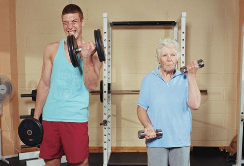 Older Woman And Younger Man In Gym