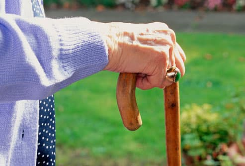 Older Woman Holding Cane
