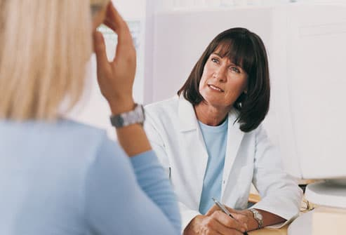 Woman Chatting With Doctor After Treatment