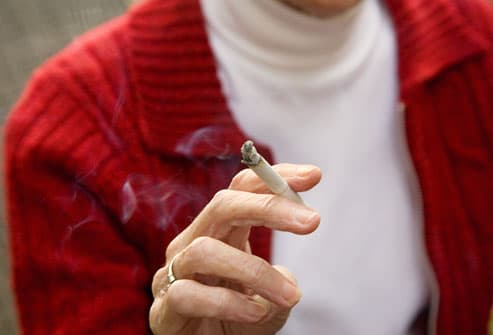 A cigarette in a woman's hand