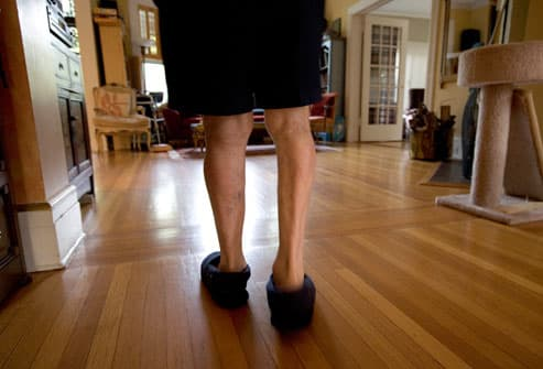 Man having difficulty walking due to Parkinsons