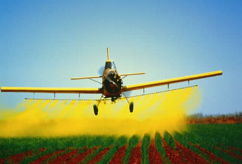 Crop duster dropping chemicals