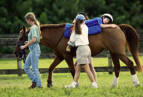 Horse therapy for autistic boy