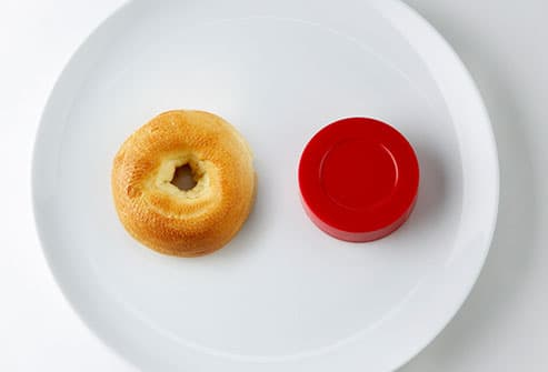bagel and hockey puck on plate
