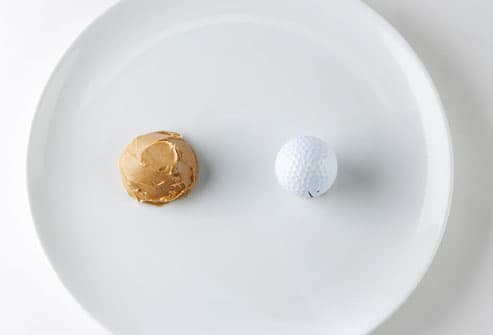 Peanut butter and golf ball on plate