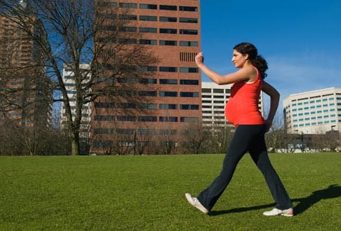 pregnant woman power walking