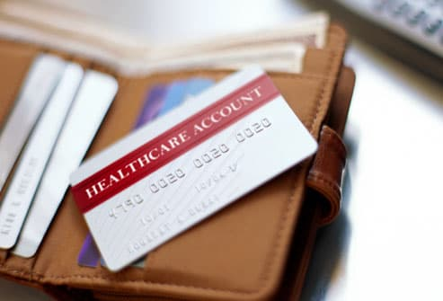 Plastic, healthcare account card on an open wallet