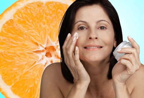 Woman Using Topical Vitamin C Skin Cream
