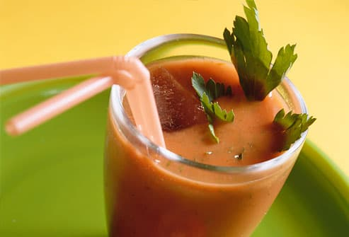 Tomato cocktail with herbs in a glass