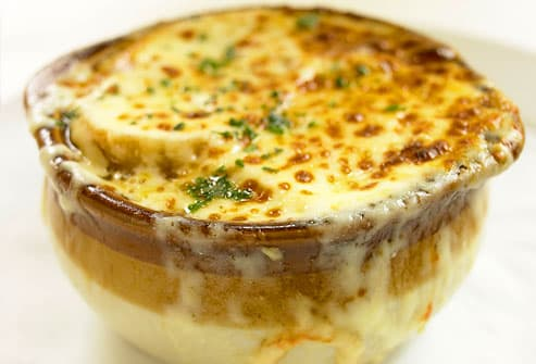 Bowl of French onion soup with melted cheese