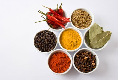 Seven spices in little white bowls