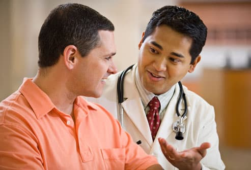 Doctor Talking To Man About Screening Test
