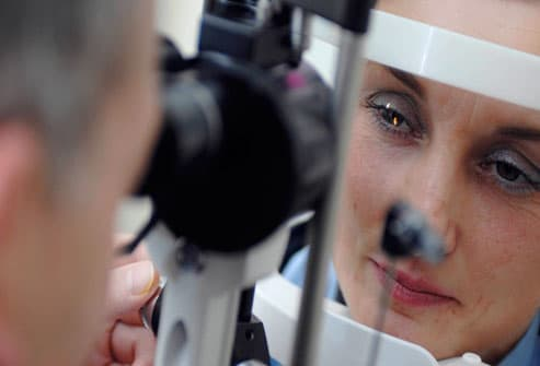 Opthalmologist Examining Woman's Eyes