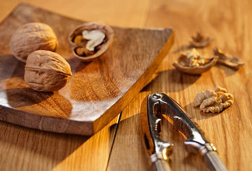 Close up of walnuts on wooden table