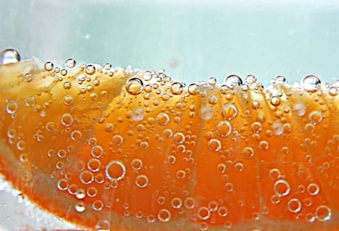 orange slice in seltzer water