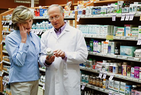 woman consulting with pharmacist