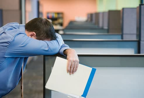 Man With Sleep Disorder Resting at Work
