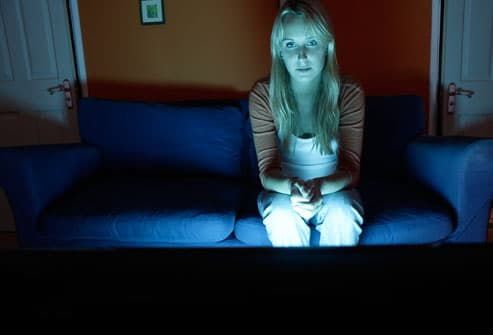 Woman Watching TV at Night
