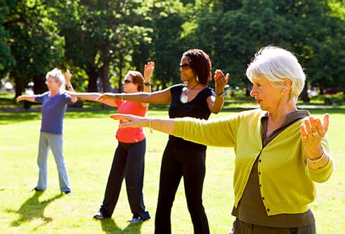 group of women practicing taichi