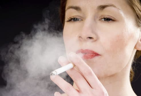 Woman Exhaling Cigarette Smoke