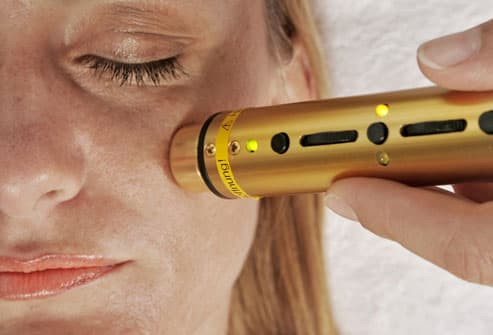 Woman Receiving Laser Therapy
