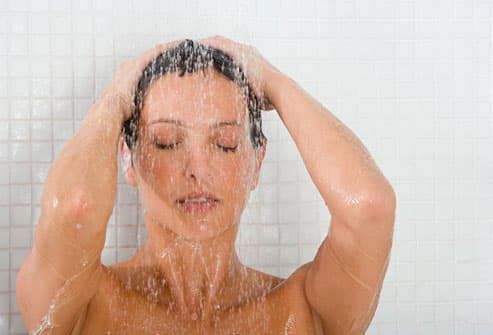 Woman Relaxing In Shower