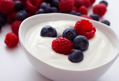 Bowl of yogurt topped with berries