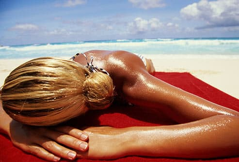 oily woman tanning