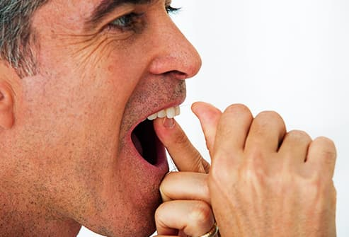 mature man flossing