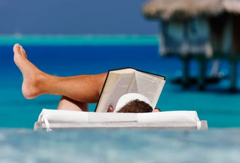 http://img.webmd.com/dtmcms/live/webmd/consumer_assets/site_images/articles/health_tools/swimming_pool_and_beach_safety_slideshow/getty_rf_photo_of_man_reading_on_beach.jpg