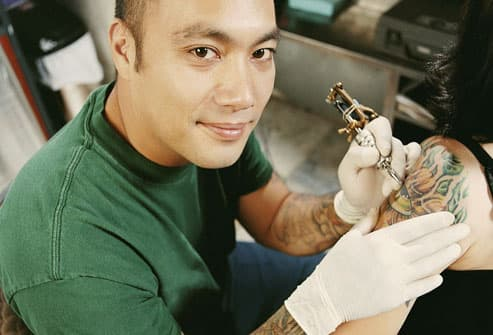 Professional tattoos are applied by registered artists using a tattoo