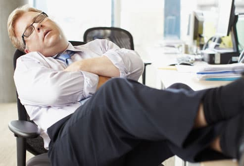 getty_rf_photo_of_man_napping_at_work.jpg