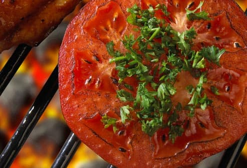 tomato cooked over a barbecue grill