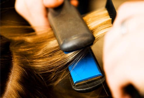 flat iron straightening hair