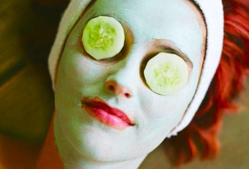 woman wearing cucumber mask