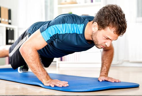 man doing push ups at home