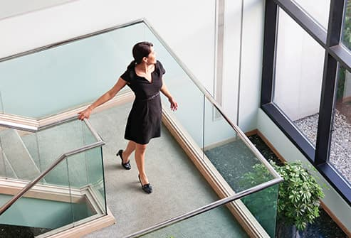 woman walking down office stairs