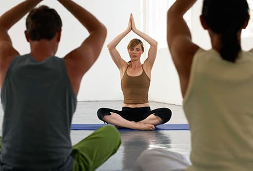 yoga teacher at front of class